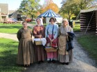 Some of the workers, in period costumes